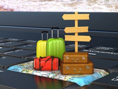suitcases, bags on the keyboard on the world map, a pointer. Vac