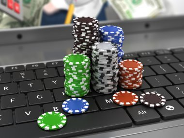 casino chips on the keyboard. Online games concept