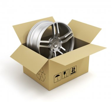 Open cardboard box with car rims on white background. Online sto