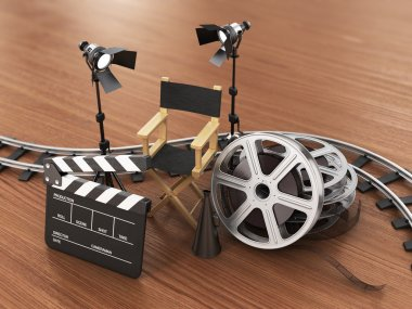 Video, movie, cinema concept. Light, film strip, reels, rails, c