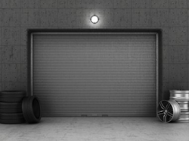 Garage building made of concrete with roller shutter doors, tire