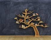 Fotografie Concept of science. Bookshelf full of books in form of tree on a