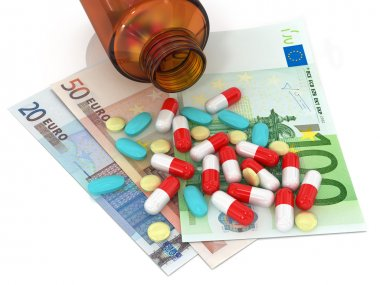 3 types of pills lying on euro banknotes and bottle of pills on