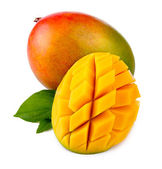 Fotografie Fresh mango fruit with cut and green leafs isolated