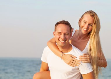 Attractive man and woman at the beach
