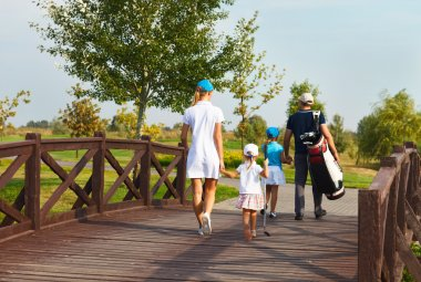 Happy family in golf country club