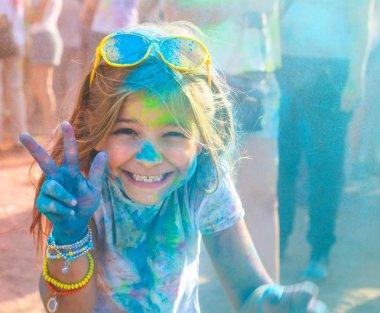 Portrait of happy cute litttle girl on holi color festival stock vector