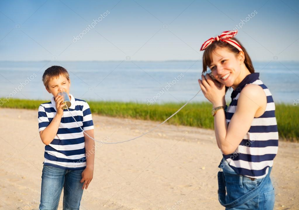 Kids having a phone call with tin cans