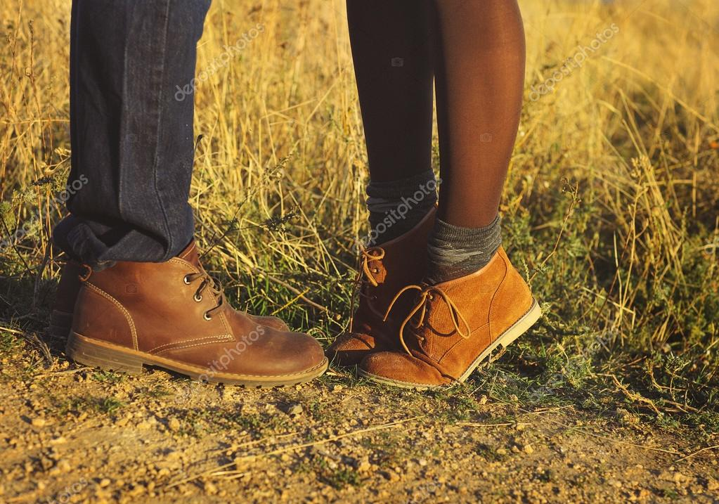 Couple man and woman feet in love romantic outdoor with autumn s