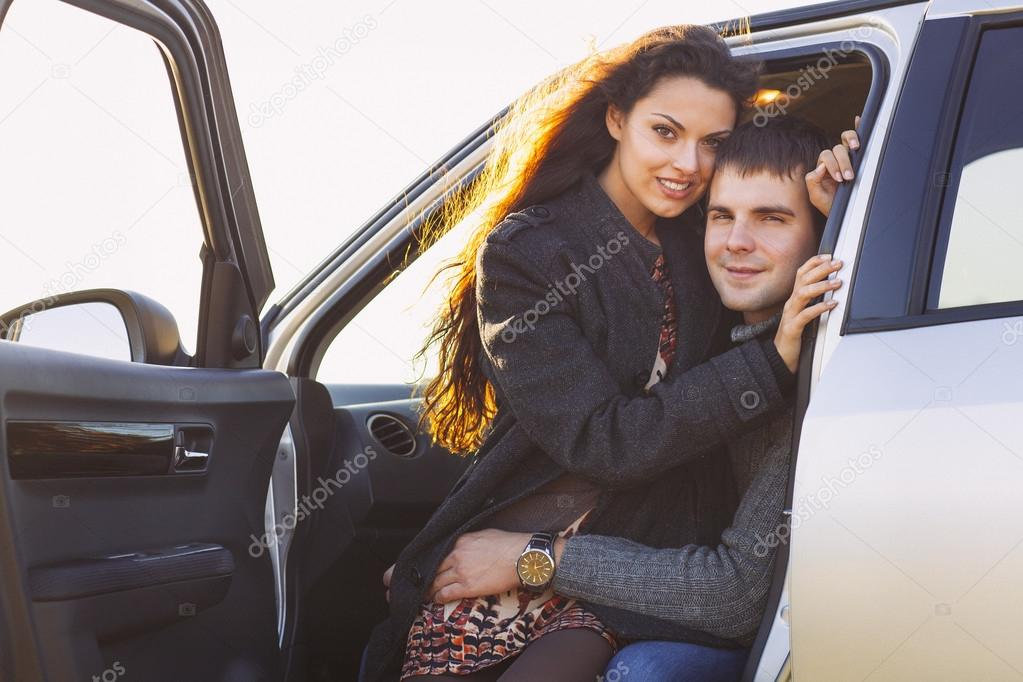 Young smile couple romantic sitting in car