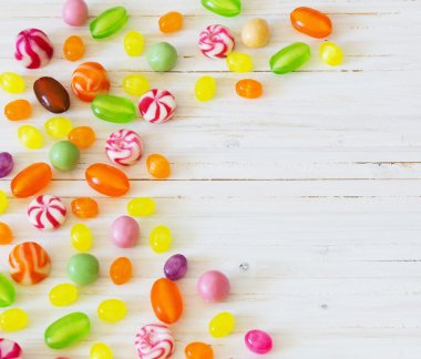 variety of candies on a wooden background