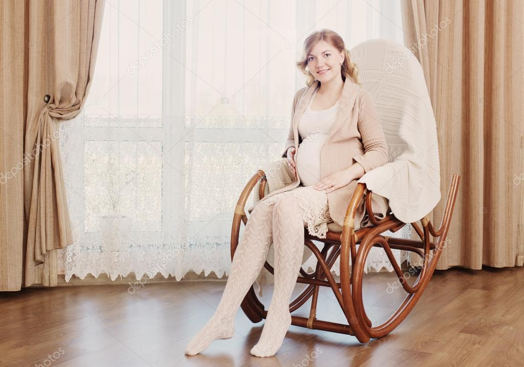 Superb Happy Pregnancy Sitting On Rocking Chair At Home Stock Creativecarmelina Interior Chair Design Creativecarmelinacom
