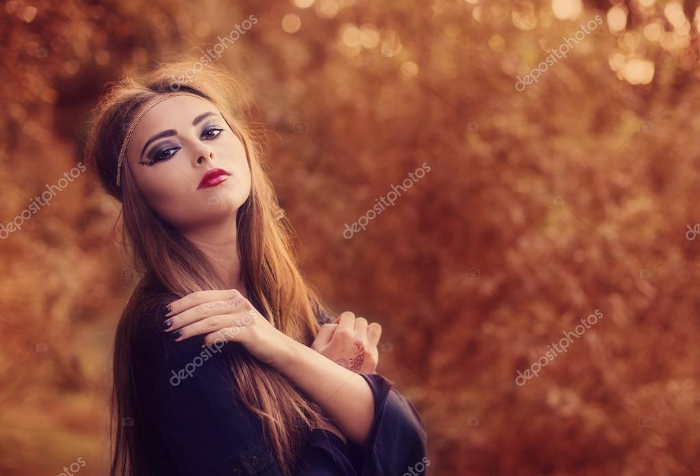 young beautiful women in autumn forest