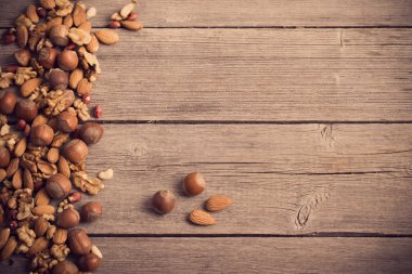 Mixed nuts on old wooden background