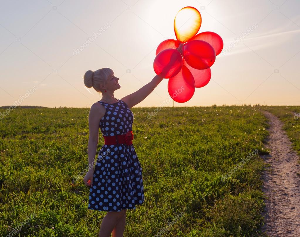 beautiful women with balloons at sunset
