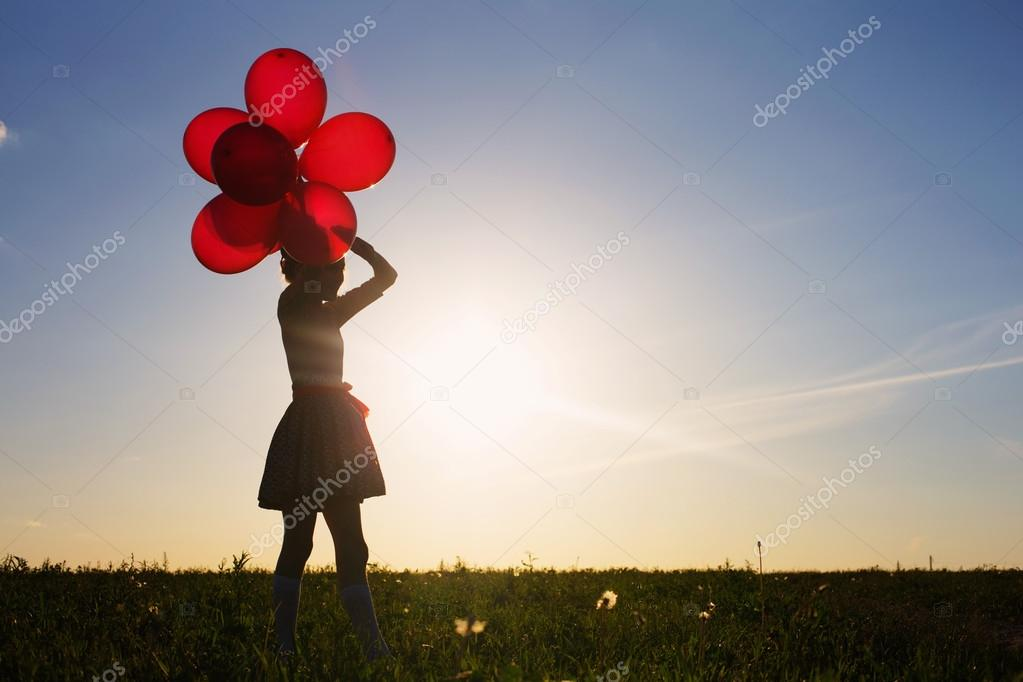 happy girl with red balloons outdoor