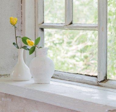 yellow roses on windowsill