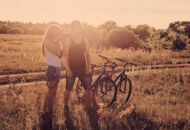 traveling couple with bicycles pictures of the landscape