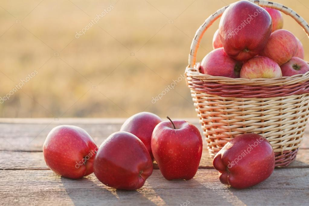 red apples on wooden table outdoor