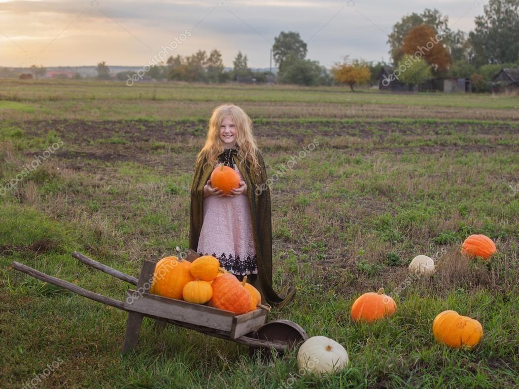 happy girl with pumpkin outdoor