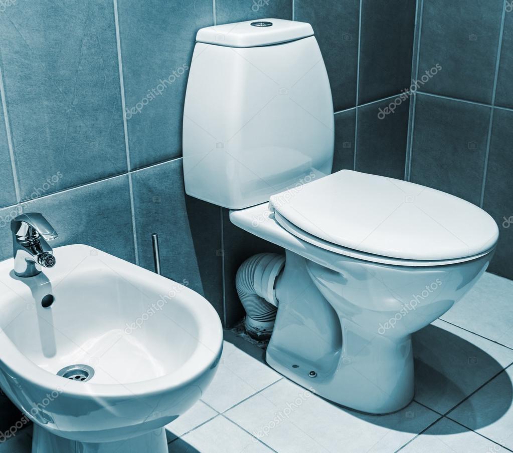 white ceramic toilet in tiled bathroom — Stock Photo © doroshin ...