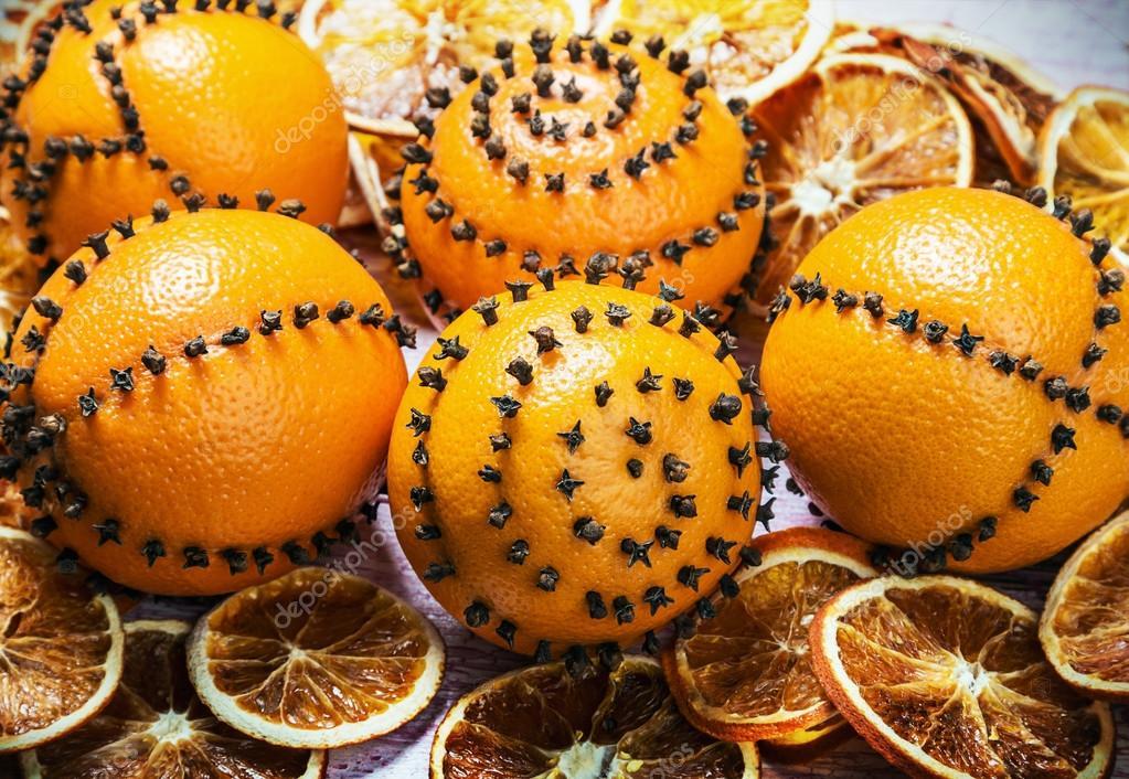 dried orange slices and oranges with cloves — Stock Photo © doroshin ...