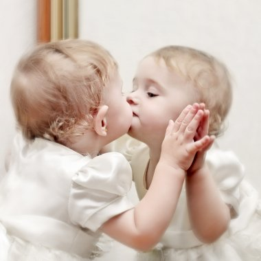 Baby kissing a Mirror
