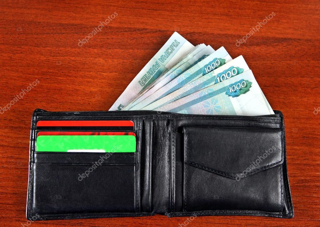 4ed06fc5a5 Ρωσικό νόμισμα στο πορτοφόλι — Φωτογραφία Αρχείου © sabphoto  66938795