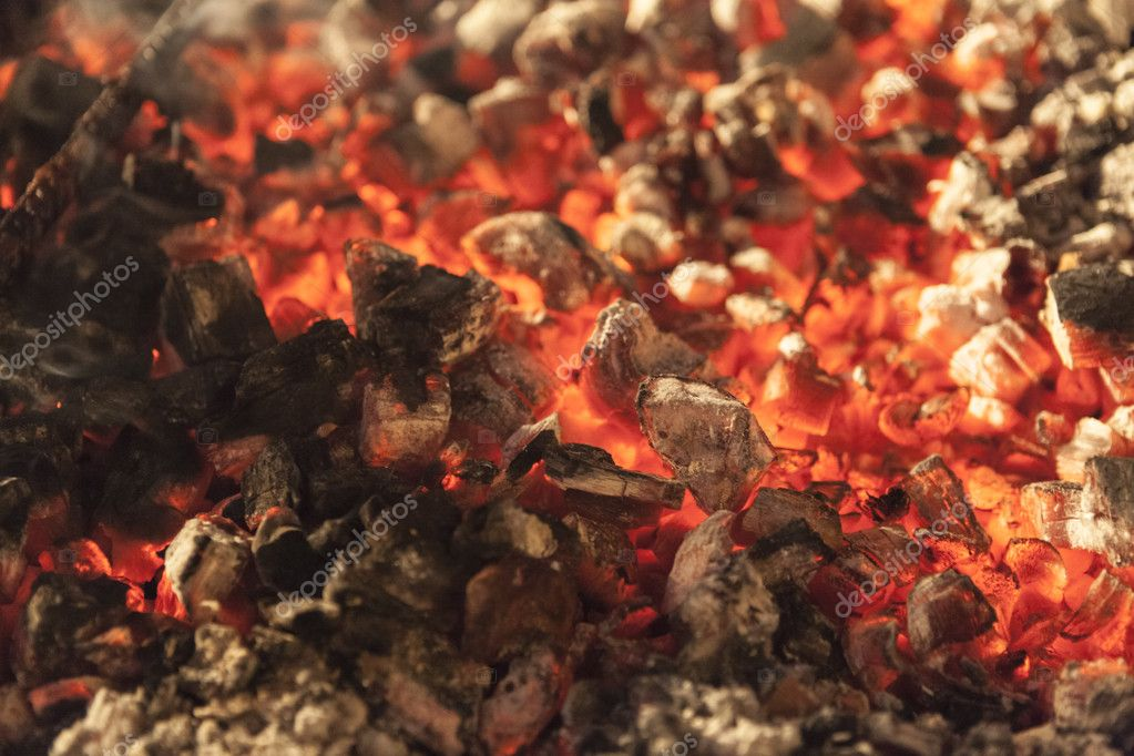 The fire, burning coals close up.