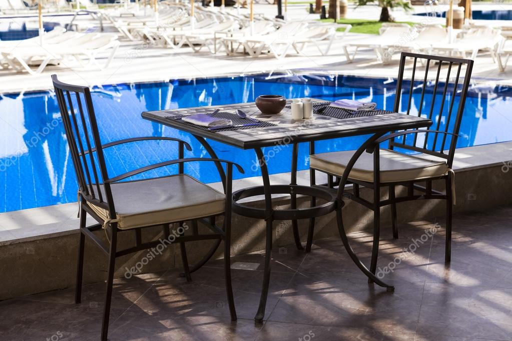 Table and chairs by the pool, Breakfast in Ibiza