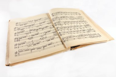 Old  music notes album on a white background