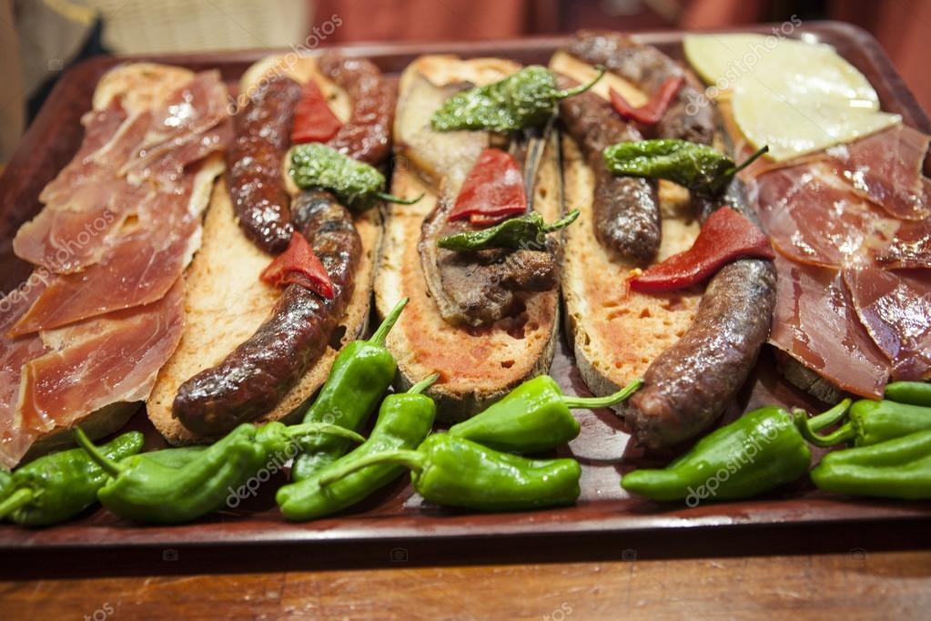 Catalan sandwiches with jamon and tomato and sausage