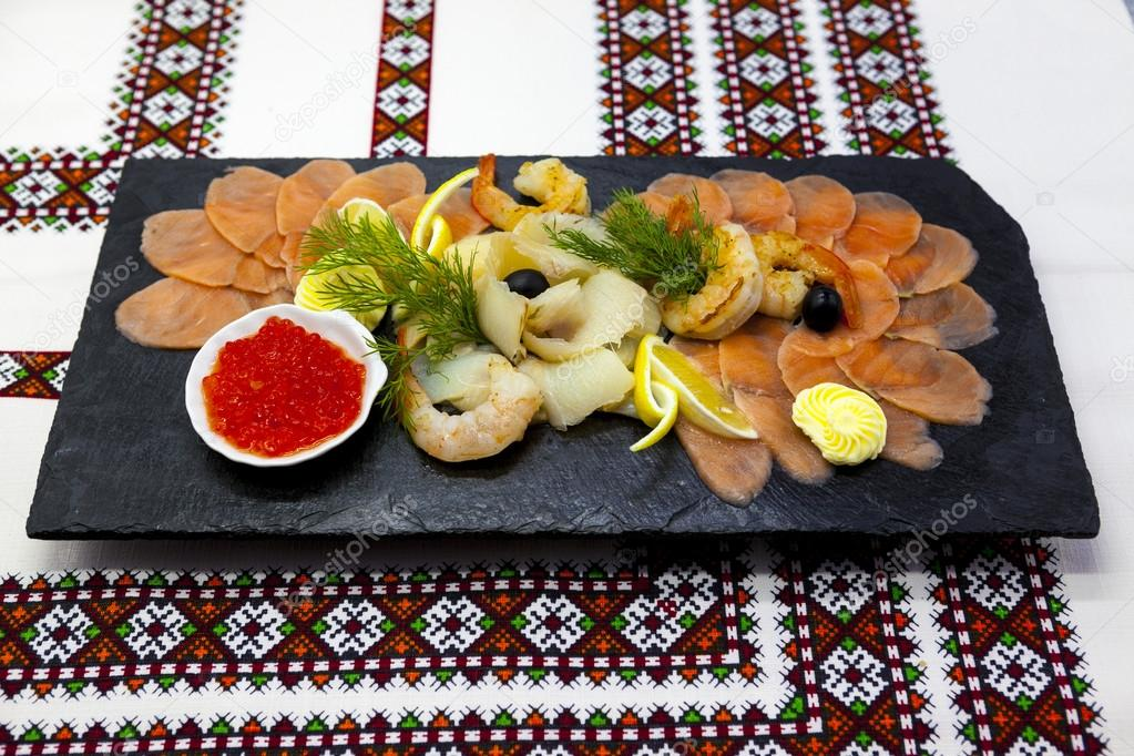 Banquet Menu Fish Assortment On A Beautiful Black Platter With Red