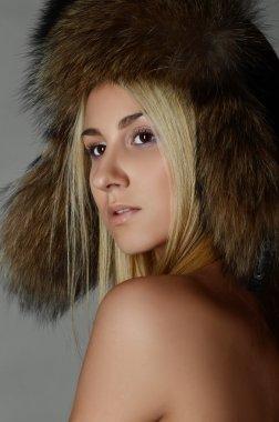 Beautiful Blond Woman in Fur Cap stock vector