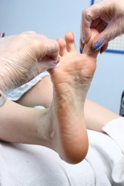 Peeling feet pedicure procedure