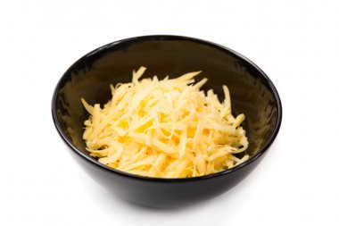 Grated cheese in a black plate