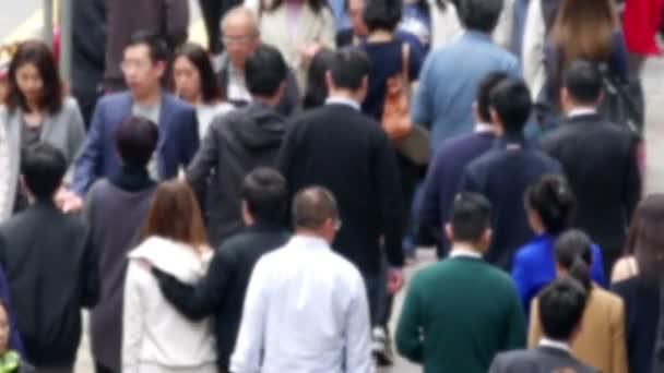 Hong Kong, China - April 01, 2016: Blurred crowd of asian people. Slow motion.