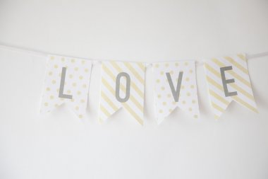 LOVE 4 alphabets decorative buntings on white wall