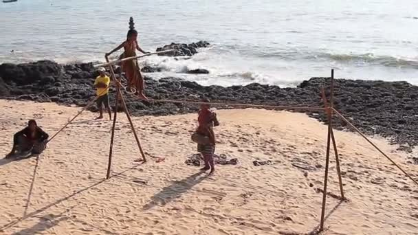 Wandering tightrope walker playing on the beach