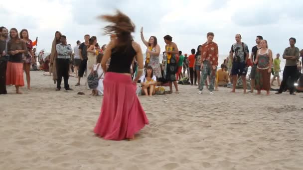 Unidentified people dancing on the beach