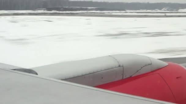 Airplane landing. View from the illuminator
