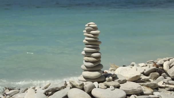 stack of zen stones on the beach