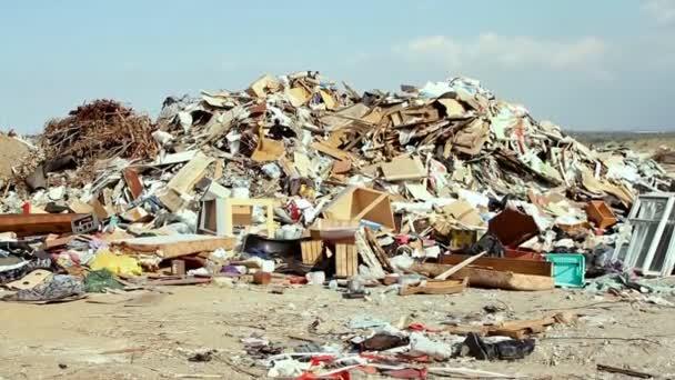 Large garbage dump waste over blue  sky