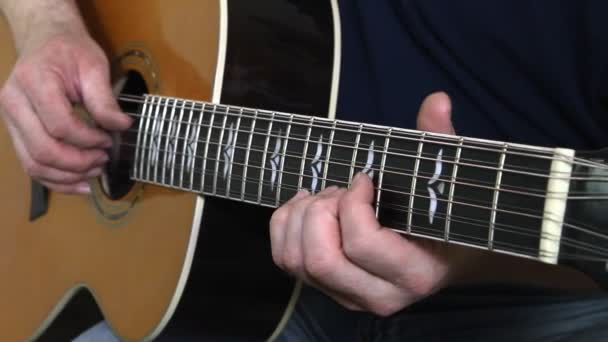 performer playing on the acoustic guitar. Musical instrument with guitarist hands
