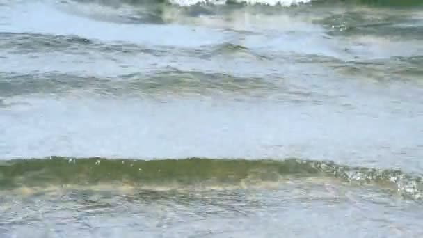 waves touching sandy beach