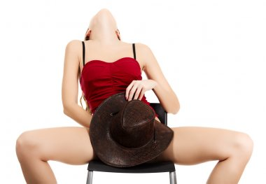 girl pleasing herself sitting on the chair
