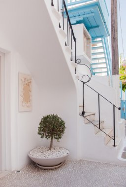 Stairs in the narrow streets of European towns - decorated with