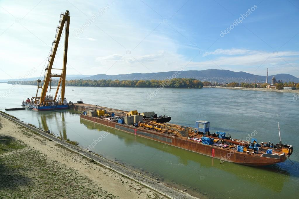 Barges with construction equipment — Stock Photo © Gudella #111324270