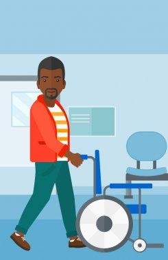 Man pushing wheelchair.