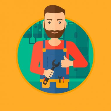 Cheerful repairman with spanner.
